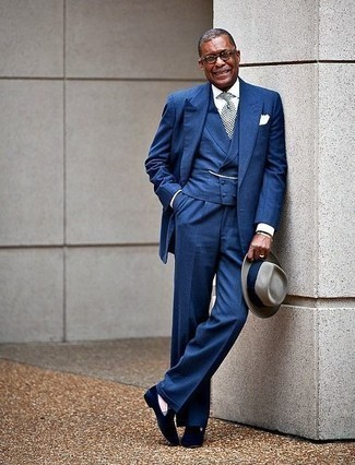 White Socks Outfits For Men: A blue three piece suit and white socks? This is an easy-to-style outfit that any gentleman can rock a version of on a day-to-day basis. And if you wish to effortlessly elevate this ensemble with shoes, complement this look with a pair of navy velvet loafers.