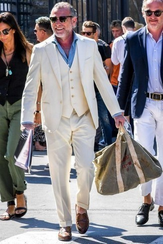 Brown Leather Loafers Outfits For Men: Wear a white three piece suit and a light blue dress shirt if you're aiming for a neat, stylish getup. For a more relaxed aesthetic, complete your outfit with brown leather loafers.