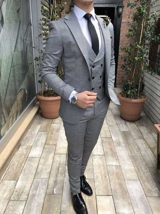 Black Tie Outfits For Men: Pair a grey three piece suit with a black tie and you're guaranteed to make an entrance. Black leather monks will bring a carefree vibe to your look.