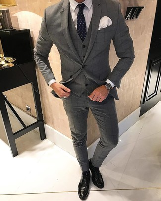How to wear: grey check three piece suit, white dress shirt, black leather oxford shoes, navy polka dot tie