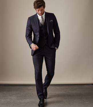 How to Wear a Navy Floral Tie For Men: A navy three piece suit and a navy floral tie are absolute essentials if you're planning a sharp wardrobe that matches up to the highest men's fashion standards. Feeling creative? Dress down your outfit by rocking black leather oxford shoes.