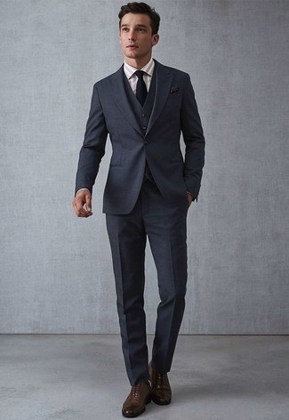 How to Wear Dark Brown Leather Oxford Shoes: A navy three piece suit and a beige vertical striped dress shirt are a savvy combination that will earn you a great deal of attention. The whole ensemble comes together when you rock a pair of dark brown leather oxford shoes.