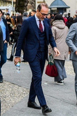How to Wear a Navy Three Piece Suit: You'll be amazed at how extremely easy it is to put together this classy ensemble. Just a navy three piece suit and a white dress shirt. The whole getup comes together when you complement your ensemble with black leather oxford shoes.