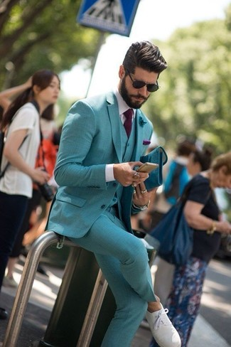 How to wear: teal three piece suit, white dress shirt, white plimsolls, dark purple tie