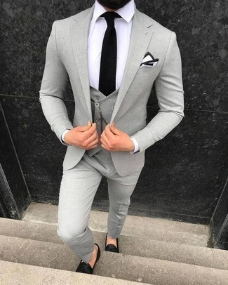How to Wear a Grey Three Piece Suit: One of the most elegant ways to style out such a staple item as a grey three piece suit is to marry it with a white dress shirt. If you want to effortlesslly dial down your getup with footwear, add black leather tassel loafers to the mix.