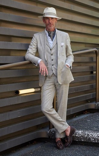 How to Wear a Grey Three Piece Suit: This pairing of a grey three piece suit and a white dress shirt is a foolproof option when you need to look elegant and incredibly sharp. And if you need to instantly dress down your look with a pair of shoes, throw dark brown woven leather tassel loafers into the mix.