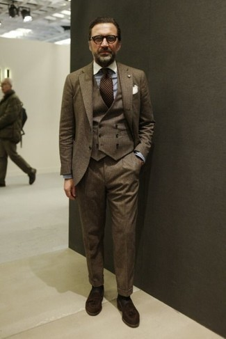 Dark Brown Polka Dot Tie Outfits For Men: Go for something sharp yet on-trend in a brown three piece suit and a dark brown polka dot tie. To give this ensemble a more relaxed aesthetic, add dark brown suede tassel loafers to the equation.