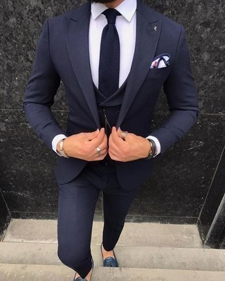 Navy and White Knit Tie Outfits For Men: A navy three piece suit looks so polished when paired with a navy and white knit tie for an ensemble worthy of a perfect gentleman. For an on-trend on and off-duty mix, complete your getup with navy leather tassel loafers.