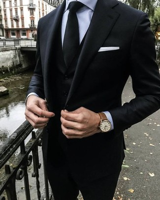 How to wear: black three piece suit, grey vertical striped dress shirt, black tie, white pocket square