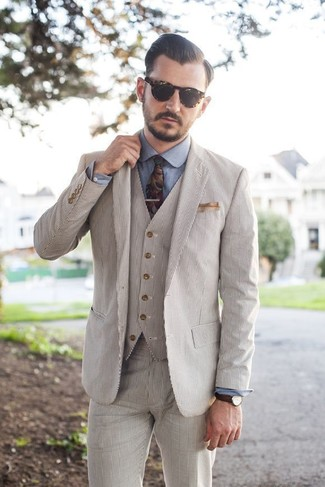 How to wear: beige seersucker three piece suit, blue chambray dress shirt, multi colored floral tie, beige pocket square
