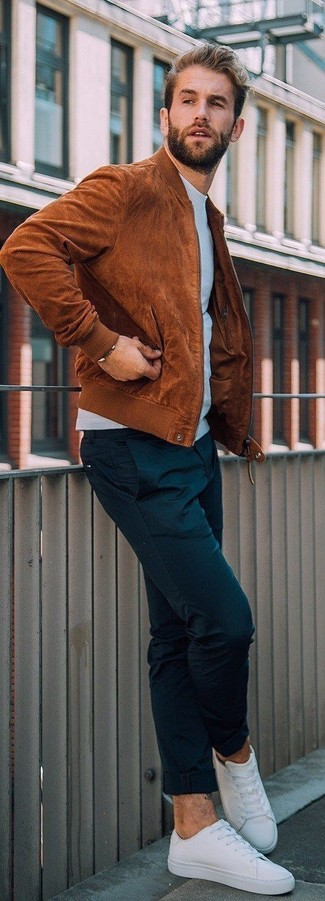 How to wear: tobacco suede bomber jacket, light blue sweatshirt, black chinos, white canvas low top sneakers