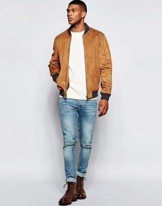 Bomber Jacket with Skinny Jeans Outfits For Men: Why not dress in a bomber jacket and skinny jeans? As well as totally comfortable, these two items look amazing worn together. In the footwear department, go for something on the dressier end of the spectrum by sporting dark brown leather brogue boots.