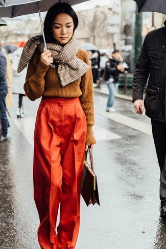 Orange Wide Leg Pants Outfits: Combining a tobacco cable sweater with orange wide leg pants is an amazing pick for a laid-back but stylish outfit.