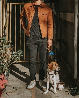 White Leather Low Top Sneakers Outfits For Men: This relaxed casual combo of a tobacco denim jacket and black jeans is a foolproof option when you need to look cool in a flash. This look is complemented really well with white leather low top sneakers.