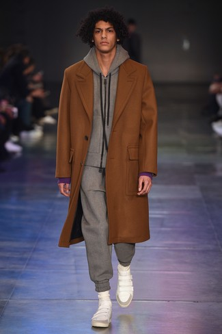 How to wear: tobacco overcoat, grey track suit, white leather high top sneakers