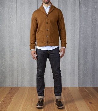 How to wear: tobacco shawl cardigan, light blue long sleeve shirt, navy jeans, dark brown leather brogue boots