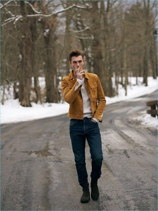 How to wear: tobacco suede shirt jacket, white v-neck sweater, navy jeans, dark brown suede chelsea boots