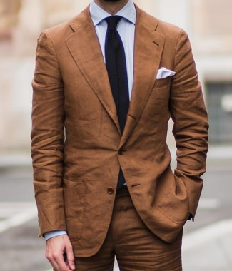 How to wear: tobacco suit, light blue dress shirt, black tie, white pocket square