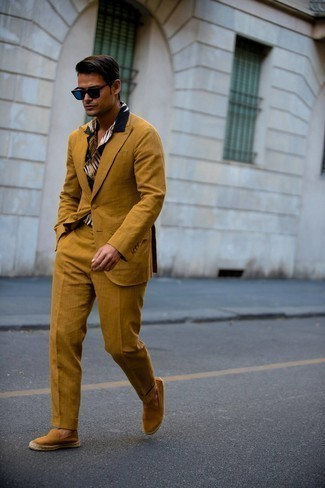Espadrilles Outfits For Men: As you can see, looking seriously stylish doesn't take that much time. Just consider teaming a tobacco suit with a navy print short sleeve shirt and be sure you'll look incredibly stylish. For a more laid-back feel, add a pair of espadrilles to your look.