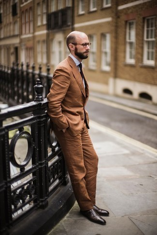 How to Wear a Suit: Rock a suit with a white dress shirt for masculine elegance with a modernized spin. Take a more casual approach with footwear and introduce dark brown leather double monks to this ensemble.