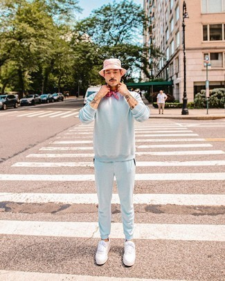Bandana Outfits For Men: Try pairing a light blue track suit with a bandana to get a city casual and absolutely dapper look. You could perhaps get a bit experimental with footwear and introduce white canvas low top sneakers to the equation.