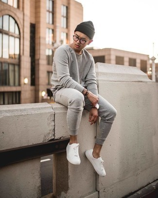 Black Beanie Outfits For Men: A grey track suit and a black beanie make for the ultimate casual look for any modern gent. A cool pair of white canvas low top sneakers is an effective way to infuse a sense of polish into your outfit.