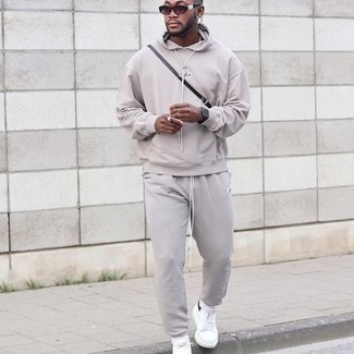 Track Suit Outfits For Men: Dress in a track suit and you'll be ready for whatever this day throws at you. For a classier twist, why not complete this outfit with a pair of white and black canvas low top sneakers?