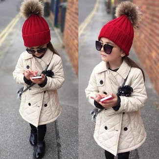 How to wear: beige trench coat, black boots, red beanie, black sunglasses