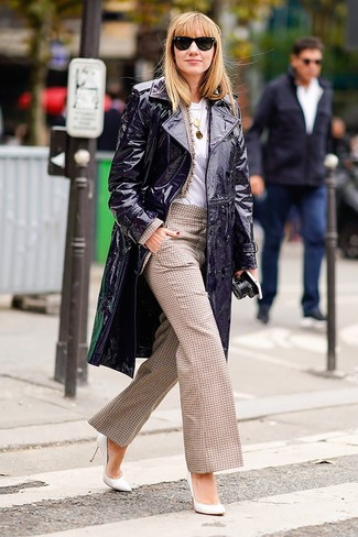 A violet leather trenchcoat looks especially elegant when paired with tan check wide leg pants. Complete this look with white leather pumps. As days are getting cooler, you'll discover that an ensemble like this is perfect for fall.