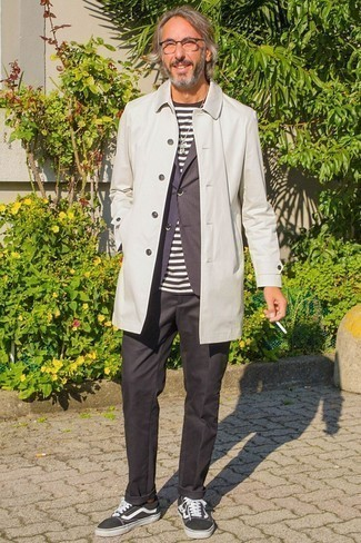 How to Wear Black Chinos After 50: A grey trenchcoat and black chinos are the kind of a winning combination that you need when you have zero time. Black and white canvas low top sneakers are a guaranteed way to add a dash of stylish casualness to your outfit.