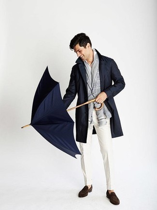 How to Wear a Scarf For Men: This relaxed casual combo of a navy trenchcoat and a scarf is very easy to throw together without a second thought, helping you look dapper and ready for anything without spending too much time combing through your wardrobe. Take this ensemble in a more elegant direction by finishing off with dark brown suede loafers.