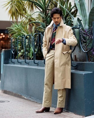 Khaki Chinos Outfits: Go for elegant style in a beige trenchcoat and khaki chinos. Wondering how to finish off this look? Rock brown leather chelsea boots to spruce it up.