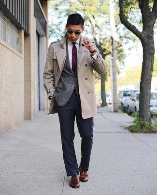Beige Trenchcoat with Brown Leather Loafers Outfits For Men: This is hard proof that a beige trenchcoat and navy dress pants are amazing when matched together in a polished outfit for today's man. Take this ensemble a more relaxed path by rocking a pair of brown leather loafers.