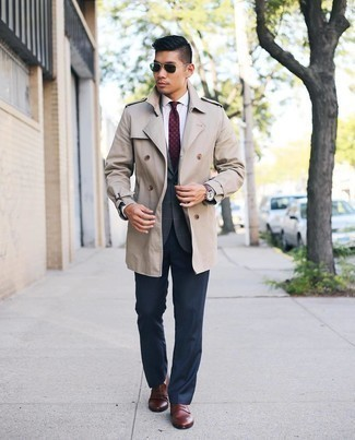 Beige Trenchcoat with Brown Leather Loafers Outfits For Men: Teaming a beige trenchcoat with navy dress pants is a savvy option for a classic and refined outfit. Brown leather loafers will give a mellow feel to your ensemble.