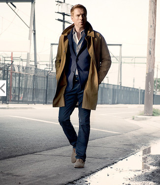 How to wear: brown trenchcoat, navy blazer, beige long sleeve shirt, navy jeans