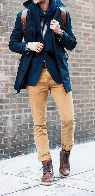 Stand out among other stylish civilians in a navy trenchcoat and tan casual pants. Finish off this look with dark brown leather boots.