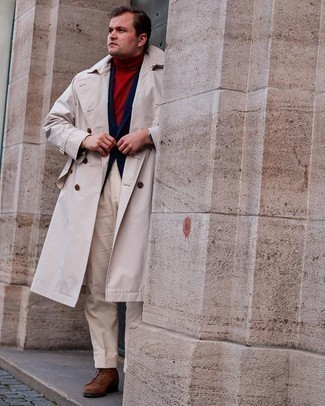 Men's Outfits 2021: You're looking at the irrefutable proof that a beige trenchcoat and beige dress pants look awesome when married together in a refined outfit for today's gent. If you want to easily play down your ensemble with one single item, introduce brown suede casual boots to the equation.