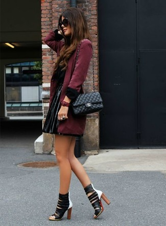 Consider teaming a burgundy trench coat with a black leather mini skirt for a comfortable outfit that's also put together nicely. Bring a touch of sophistication to your outfit with black and white leather heeled sandals. Nothing like a cool getup to cheer up a dreary autumn afternoon.