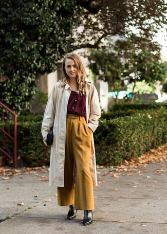 How to wear: beige trenchcoat, burgundy button down blouse, mustard wide leg pants, black leather ankle boots