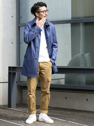 Khaki Chinos Outfits: Marrying a blue trenchcoat and khaki chinos will hallmark your skills in menswear styling. Why not make white canvas low top sneakers your footwear choice for a sense of stylish effortlessness?
