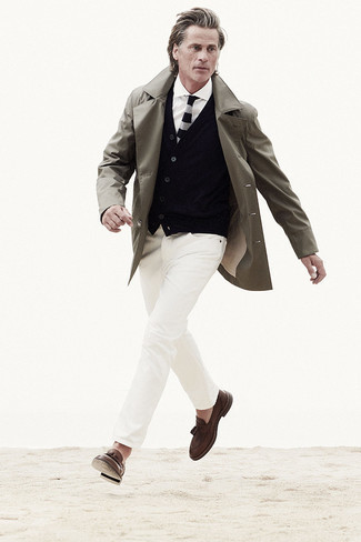 Black Cardigan Outfits For Men: Busy off-duty days call for a pared down yet cool and casual look, such as a black cardigan and white ripped jeans. Brown leather tassel loafers will lift up any look.