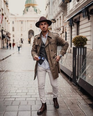 Coat Outfits For Men: Marrying a coat and beige chinos is a fail-safe way to breathe sophistication into your styling routine. And if you need to instantly polish off this look with one single item, why not introduce a pair of dark brown leather chelsea boots to your getup?
