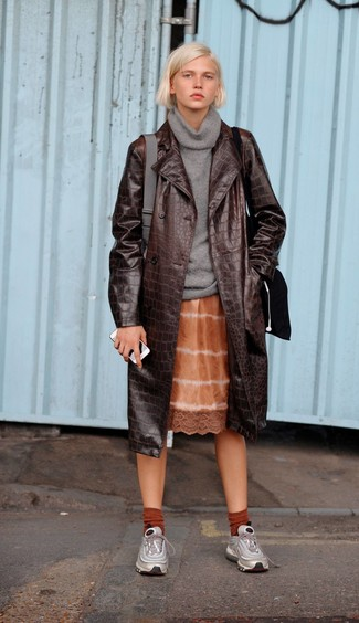 How to wear: dark brown leather trenchcoat, grey cowl-neck sweater, orange tie-dye cami dress, silver athletic shoes