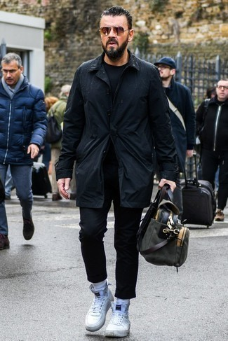 How to Wear a Black Trenchcoat For Men: Channel your inner fashionisto and pair a black trenchcoat with black chinos. Go the extra mile and spice up your look by slipping into white high top sneakers.