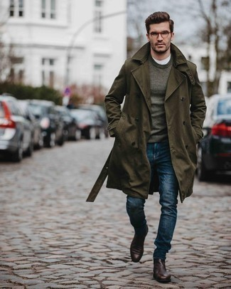 Dark Brown Leather Chelsea Boots Outfits For Men: An olive trenchcoat and navy jeans are the kind of effortlessly smart items that you can wear for years to come. Ramp up this whole outfit by finishing off with a pair of dark brown leather chelsea boots.