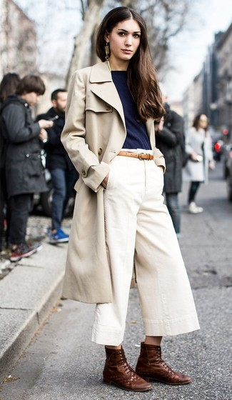 How to Wear Dark Brown Leather Lace-up Flat Boots For Women: This relaxed pairing of a beige trenchcoat and white culottes is a life saver when you need to look chic but have no extra time. Serve a little outfit-mixing magic by slipping into dark brown leather lace-up flat boots.