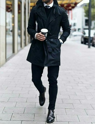 How to Wear a Black Trenchcoat For Men: This pairing of a black trenchcoat and black jeans is a must-try effortlessly classic getup for today's gentleman. You know how to dress it up: black leather double monks.