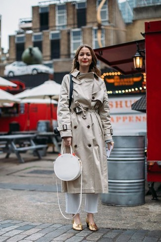 How to wear: beige trenchcoat, grey crew-neck sweater, white jeans, gold leather pumps