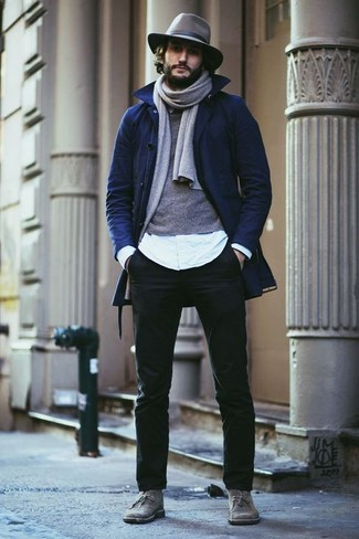 Wear a navy trenchcoat and black casual pants for your nine-to-five. Rock a pair of grey suede desert boots for a more relaxed aesthetic. Loving that this ensemble is great when fall arrives.