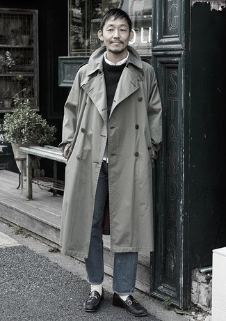 Charcoal Jeans Outfits For Men: This combo of a grey trenchcoat and charcoal jeans is proof that a straightforward ensemble doesn't have to be boring. Introduce a pair of black leather loafers to the equation to make the look a bit more refined.